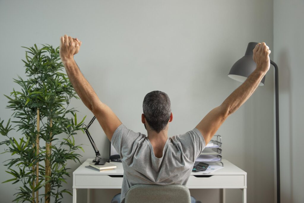 Men Stretching While Working